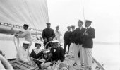 1411-King Alfonso's party aboard Shamrock. Sir Thomas Lipton and Queen of Spain in shot. c1910.
