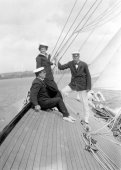 1422-Colonel Neill, Sir Thomas Lipton and the Queen of Spain aboard Shamrock. c1910.