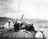 1570-View of helm of Shamrock with Sir Thomas Lipton and crew. c1900.