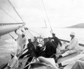 1573-View of helm and deck of Shamrock with Sir Thomas Lipton and crew. c1900.