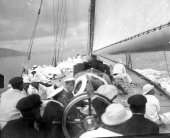 1574-View of helm and deck of Shamrock with Sir Thomas Lipton and crew. c1900.