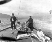 1575-View of helm and deck of Shamrock with crew. Colonel Neill on deck. c1900.
