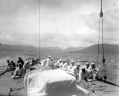 1578-View of crew seated on Shamrock's decks. c1900.