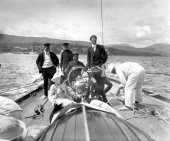 1580-View of Shamrock's helm with crew and two ladies. c1900.