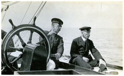Captain Turner and Charles E. Nicholson at the helm of Shamrock IV during trials