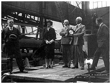 Camper & Nicholsons celebrates the firm's 150th Anniversary. Charles Nicholsons is the gentleman holding the presentation clock and which brother Arthur Nicholson is on his right.