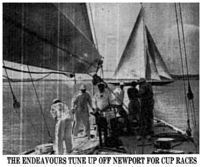 THE ENDEAVOURS TUNE UP OFF NEWPORT FOR CUP RACES - Captain D. H. Williams at wheel of Endeavour II as she gets under way on Narragansett Bay. Above to the left is the big English Park Avenue boom on the British sloop. In the background the first Endeavour, which in 1934 was defeated for the mug, is seen under full sail.